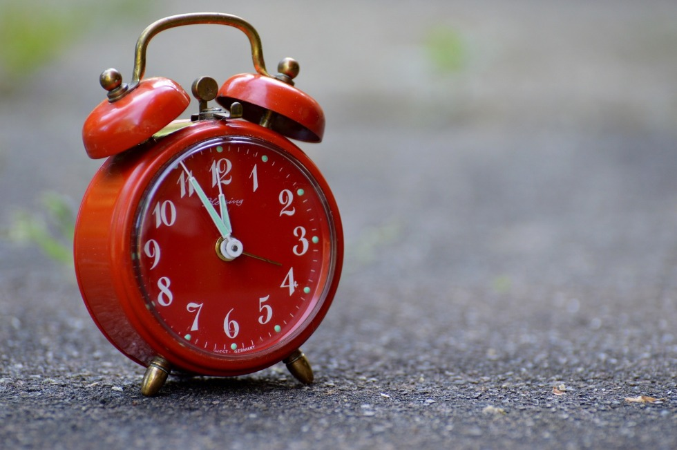 Red old fashion alarm clock